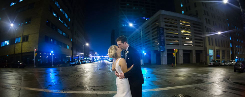 emily-johnson-photography-best-wisconsin-wedding-photographer-end-of-night-pictures-bride-groom-street-city-lights-winter-downtown-milwaukee-athletic-club-980x390